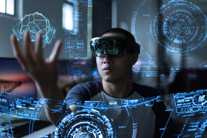 Men playing virtual reality with hololens. khoamartin / Shutterstock.com