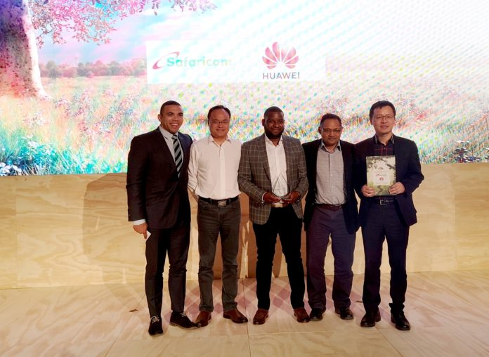 """Safaricom and Huawei Executves at AfricaCom 2019, winners of """"Most Innovative Service"""" Award."""