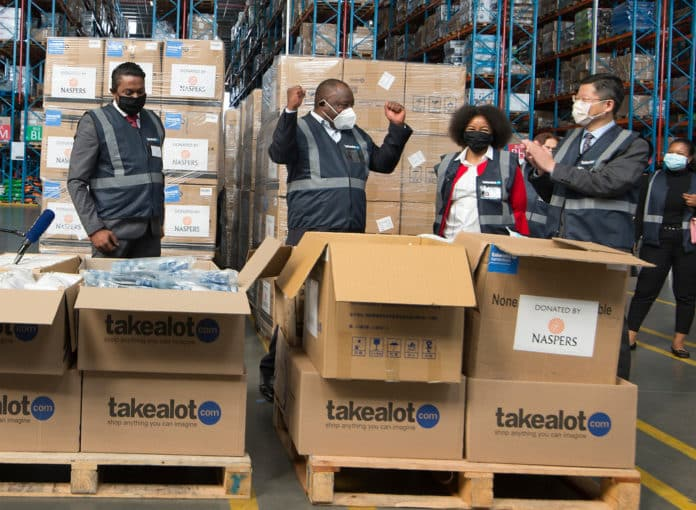 President Cyril Ramaphosa received the equipment at Takealot's Distribution Centre